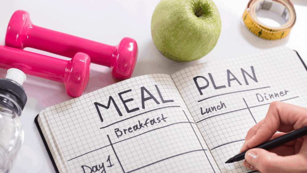 Keep a food diary and follow a plan to lose belly fat over the next 14 days.